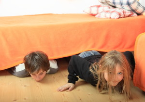 kids slinking from under bed